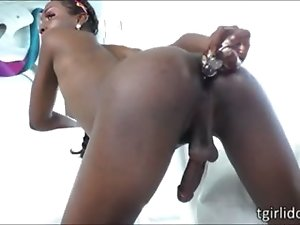 Intense black tgirl Neveah strokes cock