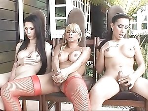 3 hot shemales stroking their cocks under  the porch