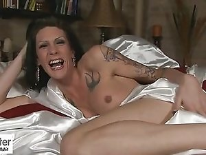 Tranny with Tattoos Morgan Strokes in Bed