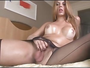 Gorgeous Tranny Raissa in Pantyhose Strokes Her Dick