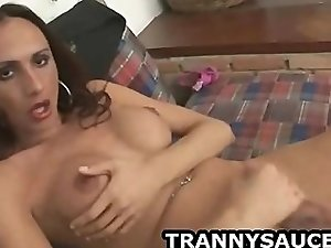 Sexy brunette shemale babe tugging on her har